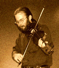 Tim Ball fiddler for                     O'Shanigans - photo by Raylene Ludgate ok to use for                     publicity
